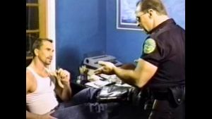 Cop Hassles Slacker at the Tax Office.