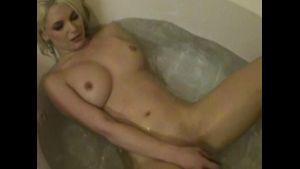 Silly Blonde in Bathtub with Vibrator.