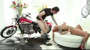 Biker fucking a tattooed slutty blonde.