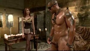 Red Haired Mistress Whips and Taunts Chained Black Slave.