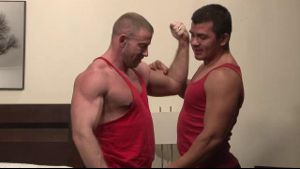 Muscle Men in Red Shirts.