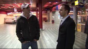 A Train Station, a Businessman and a Slacker.