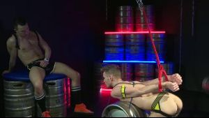 Chained and Roped to Beer Kegs.