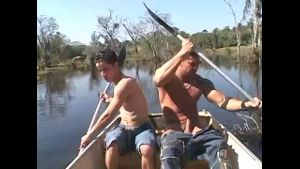 A Muscleman and a Twink in a Rowboat.