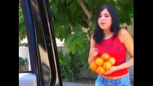 Cute Latina Selling Oranges.