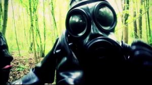 Girl on Girl Wearing Gas Masks.