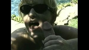 Malibu Blonde Gives Blowjob in Sunglasses.